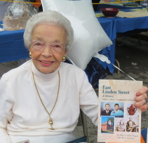 Ella J. Sestrich displays the book she co-authored with the late Mary Larkin Dugan, an advocate of the East Linden Street Project who was honored at the gala.