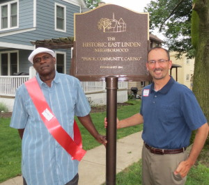 "Historic East Linden Street Project board member Barry ""Hap"" London (from left) shows off the neighborhood's new plaque with Kennett Square Borough Council President Dan Maffei."