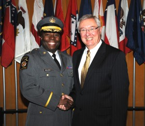 Capt. Maurice L. Tomlinson (left) is congratulated by Pennsylvania State Police Commissioner Frank Noonan.