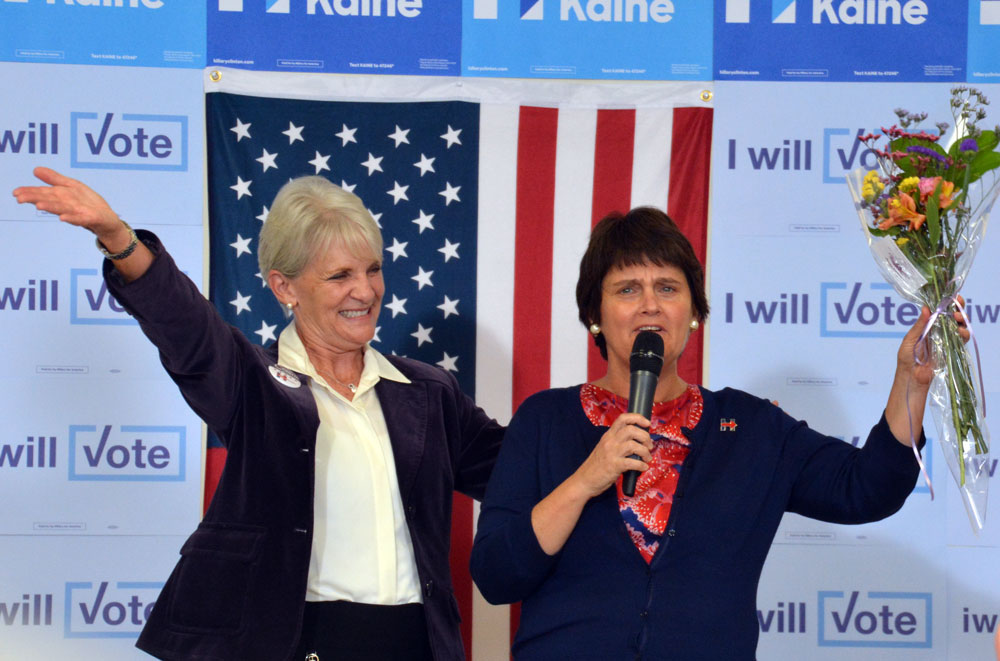 West Chester Mayor Carolyn Comitta shares a moment with Anne Holton, wife of Democratic Vice Presidential nominee Tim Kaine during a voter registration event Saturday.